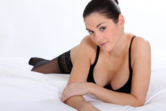 Woman in bra and stockings Stock Images
