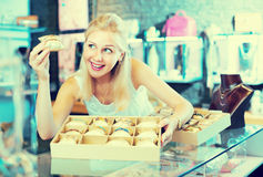 Woman with bracelet collection in bijouterie boutique Stock Image
