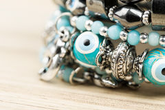 Woman bracelet on wooden background Stock Images