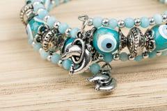 Woman bracelet on wooden background Stock Photography