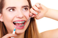 Woman with braces having dentist appointment Royalty Free Stock Photo