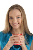 Woman with brackets on teeth and cup Stock Photos