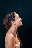 Woman with braid hairdo. Portrait of young woman with braid hairdo royalty free stock photo