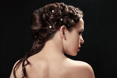 Woman with braid hairdo. Portrait of young woman with braid hairdo Royalty Free Stock Photography