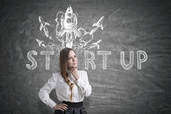 Woman with a braid and startup rocket Stock Images
