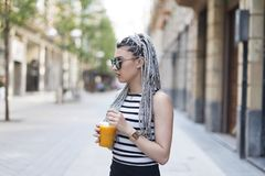 Woman with braided hair and fruit shake. Stock Photos