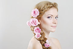 Woman with with braids and roses in hair Royalty Free Stock Images