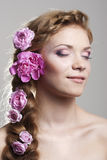 Woman with with braids and roses in hair Stock Images