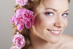 Woman with with braids and roses in hair Royalty Free Stock Photos