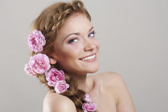 Woman with with braids and roses in hair Royalty Free Stock Photography