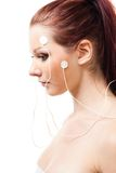 Woman with brain sensors on her face Stock Images