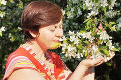 Woman with a branch of the apple tree Royalty Free Stock Photo