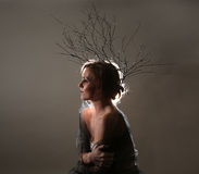 Woman With Branches as a Creative Head Piece. Petite Woman With Branches as a Creative Head Piece Royalty Free Stock Photos