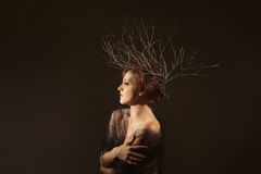 Woman With Branches as a Creative Head Piece. Petite Woman With Branches as a Creative Head Piece Royalty Free Stock Photography