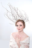 Woman With Branches as a Creative Head Piece Stock Photography