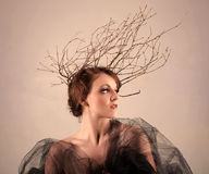 Woman With Branches as a Creative Head Piece. Petite Woman With Branches as a Creative Head Piece Royalty Free Stock Images