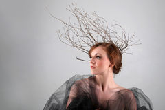 Woman With Branches as a Creative Head Piece. Petite Woman With Branches as a Creative Head Piece Stock Images