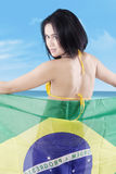 Woman with Brazilian flag at the coast Royalty Free Stock Images
