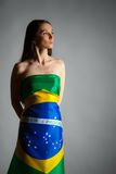 Woman in the Brazilian flag. On the gray background Royalty Free Stock Photos