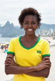 Woman in brazilian jersey with crossed arms at Rio de Janeiro Stock Photos