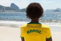 Woman in brazilian jersey looking at Sugarloaf mountain at Rio Royalty Free Stock Images
