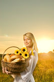 Woman with a bread Royalty Free Stock Photos