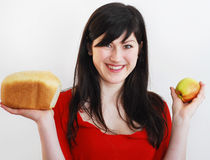 woman with bread and apple Royalty Free Stock Image
