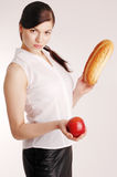 Woman with bread and apple, on diet Stock Image