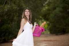 Woman with bread in the basket Stock Photos