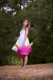 Woman with bread in the basket Royalty Free Stock Images
