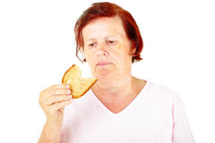 Woman with bread Stock Photography