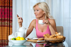 Woman at breakfast Stock Image