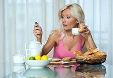 Woman at breakfast Royalty Free Stock Photo