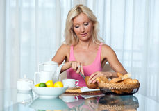 Woman at breakfast Stock Photos