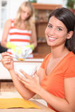 Woman at breakfast Stock Images