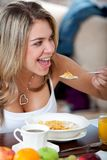 Woman at breakfast Stock Photo