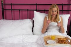 Woman with breakfast in bed Stock Photos