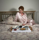 Woman with Breakfast in Bed Royalty Free Stock Image