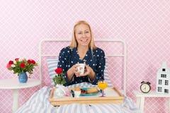Woman breakfast on bed Stock Photos