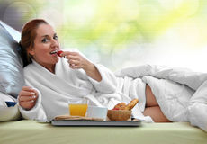 Woman breakfast in her bed Stock Photography