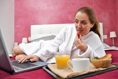 Woman breakfast in her bed Stock Photo