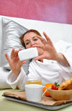 Woman breakfast in her bed peacefully Royalty Free Stock Photos