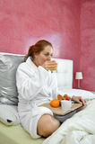 Woman breakfast in her bed peacefully Royalty Free Stock Photography