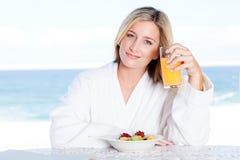 Woman breakfast juice Royalty Free Stock Image