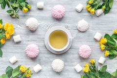 Woman breakfast with roses and marsh-mallow light wooden table top view pattern Royalty Free Stock Images