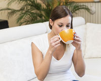 Woman breakfast sofa Stock Photo