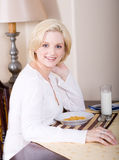 Woman at breakfast table Royalty Free Stock Images