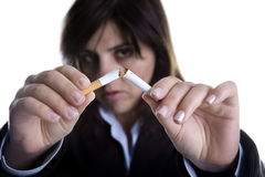 Woman breaking cigar - anti-tobacco concept Stock Photos