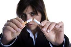 Woman breaking cigar - anti-tobacco concept Stock Photos