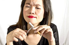 Woman breaking cigarette Stock Photo